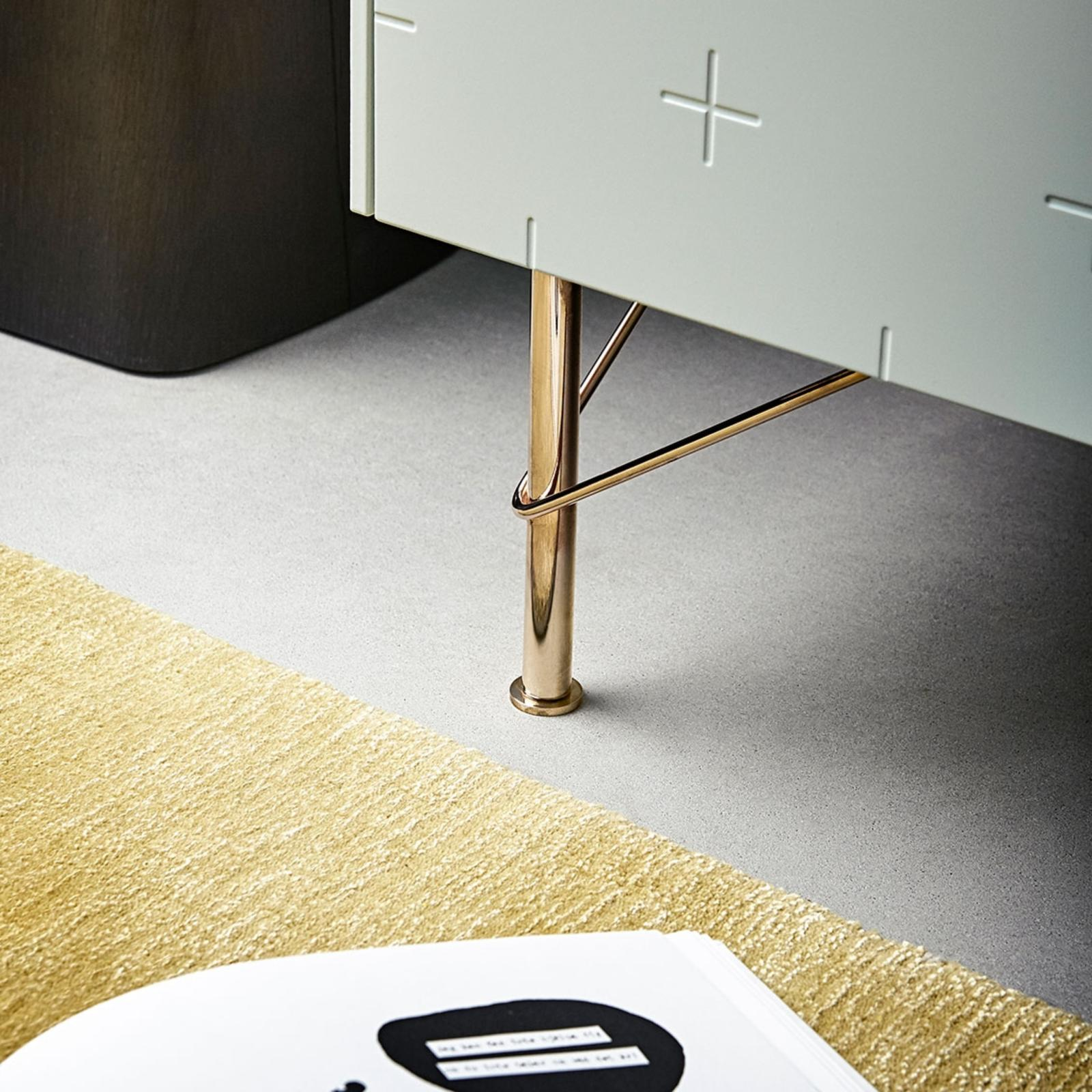 Furniture leg in brass on a frame from Ikea with sage green cabinet fronts from Superfront