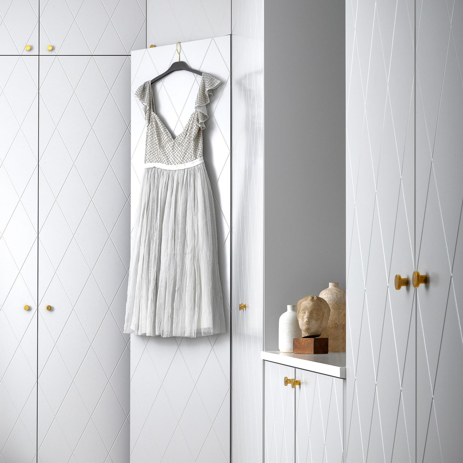 Custom built walk in closet in pale grey from Superfront, with Pax frame from Ikea
