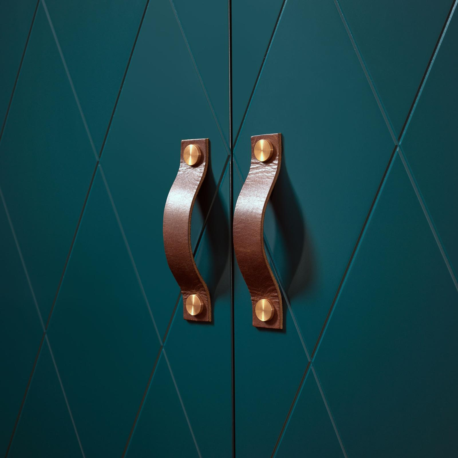 Brown leather handles from Superfront, mounted on bottle green wardrobe fronts