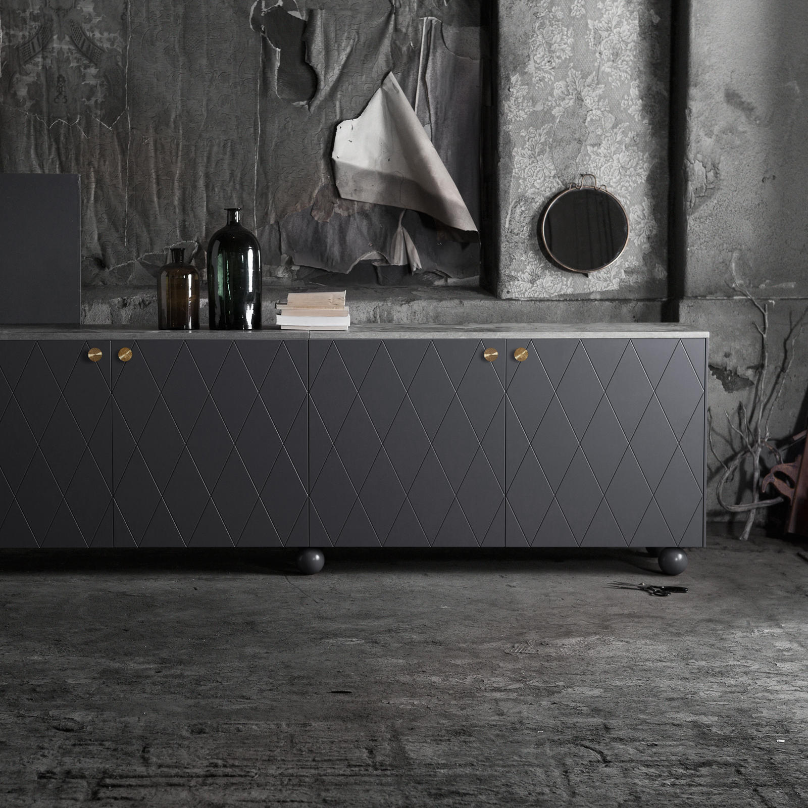 Sideboard built from a Bestå cabinet frame with dark grey, patterned fronts and round handles in copper