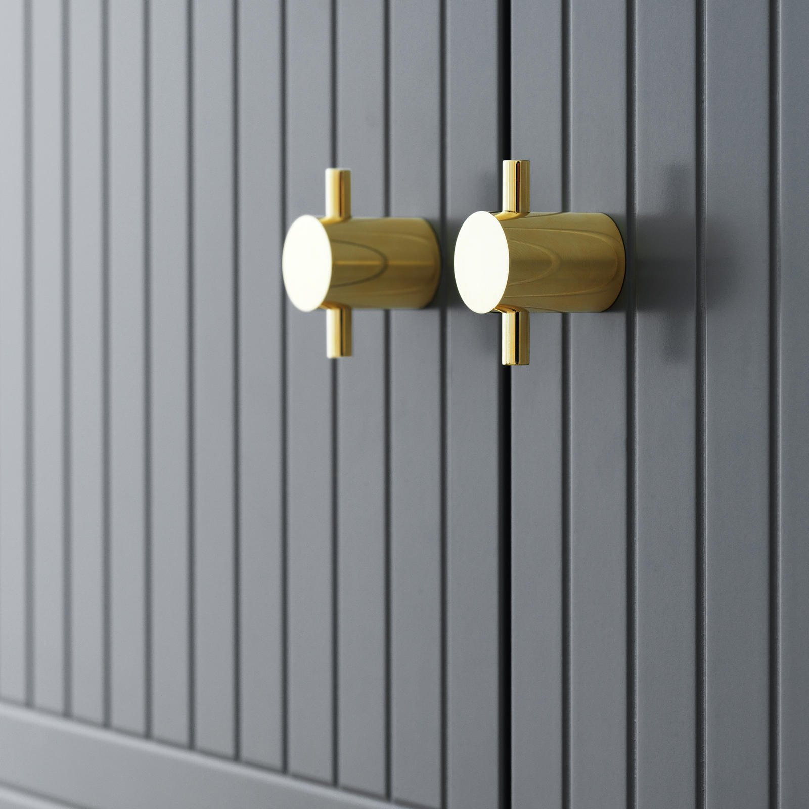 Handle in solid brass on grey, patterned fronts from Superfront