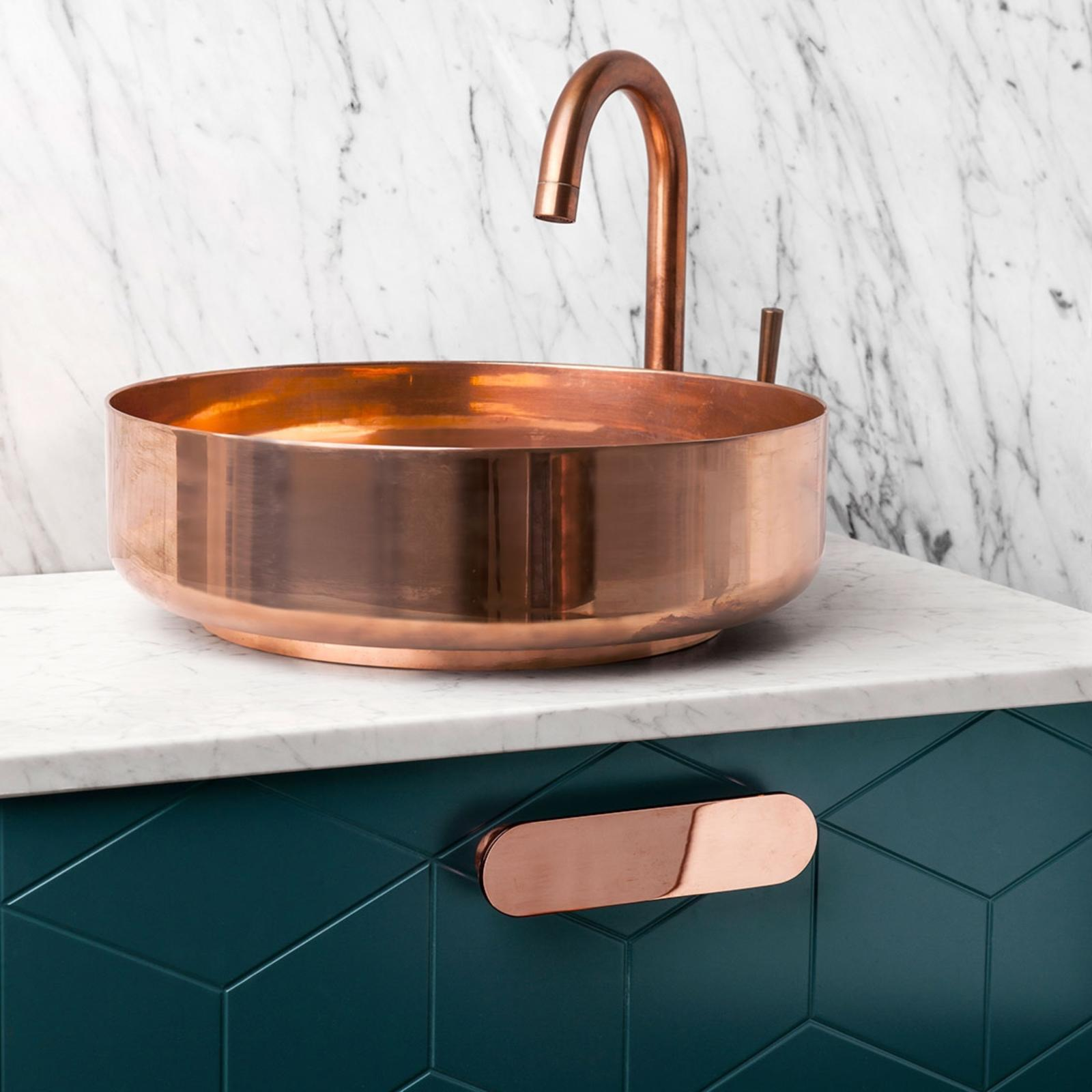Green bathroom vanity from Superfront with copper details and marble top